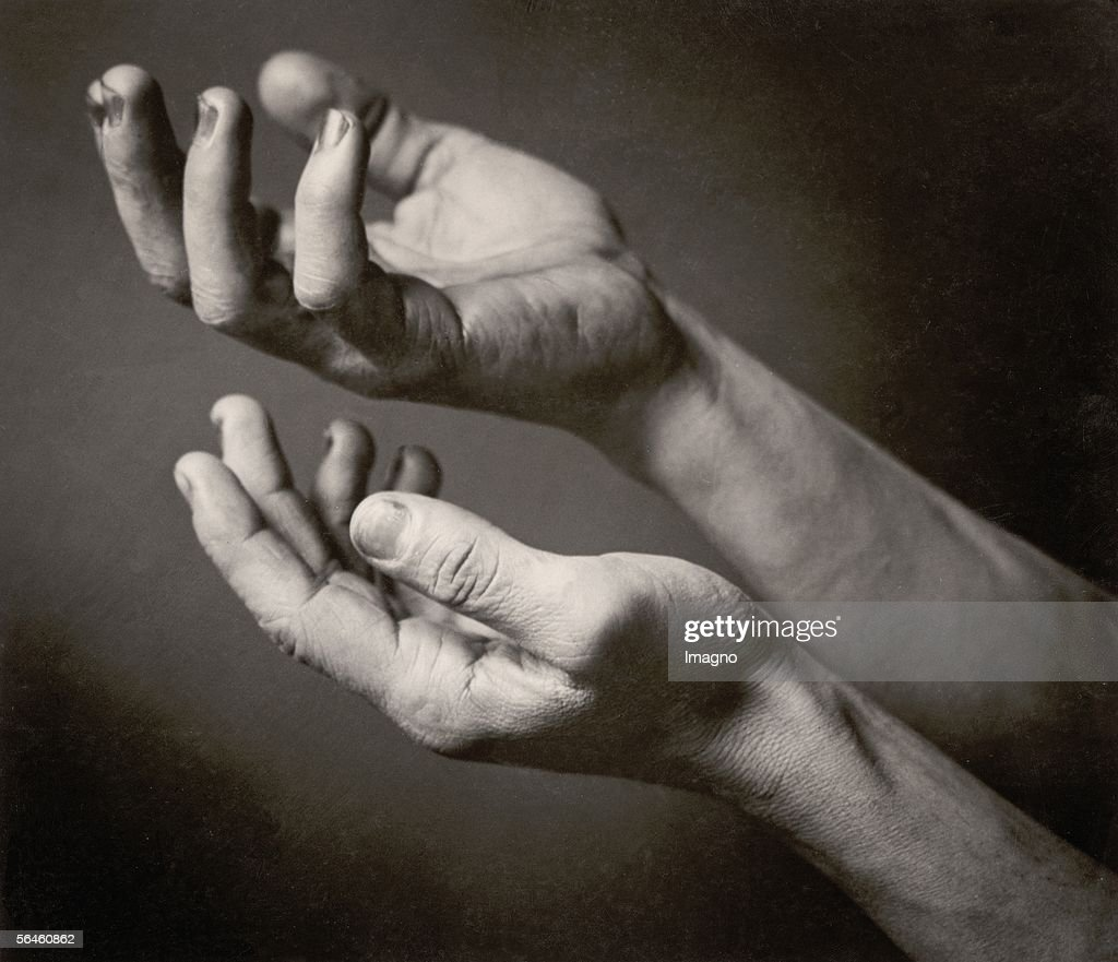 Pleading hands : News Photo