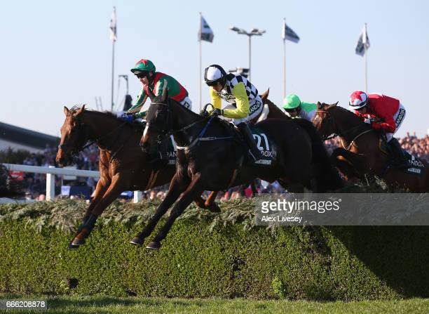 Pleasant Company ridden by Ruby Walsh clears the Water Jump during the 2017 Randox Health Grand National at Aintree Racecourse on April 8 2017 in...