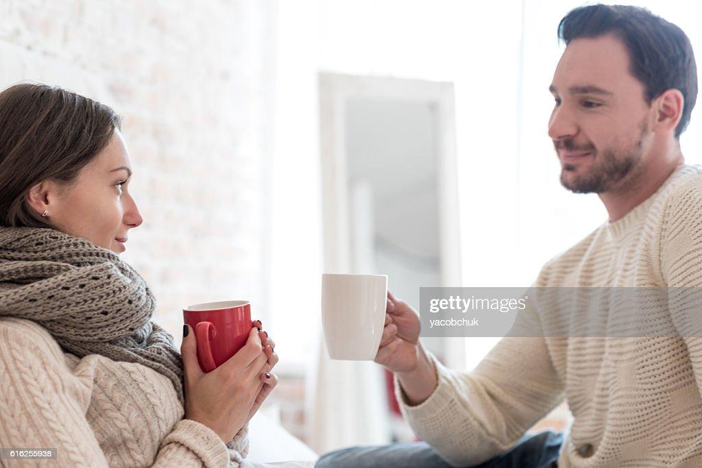 Pleasant happy couple having tea : Foto de stock