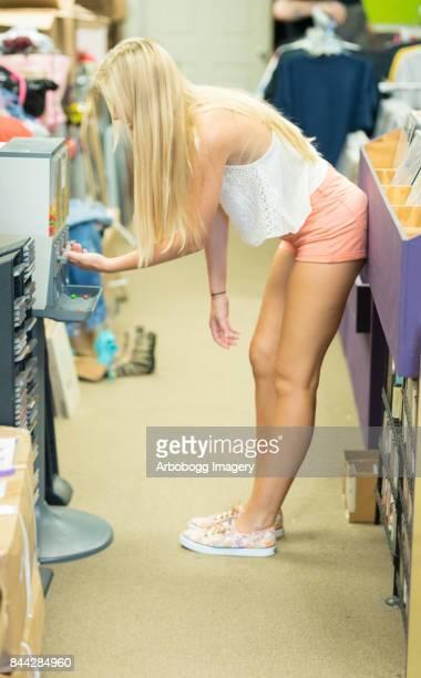 pleasant young lady at candy machine - sugar baby imagens e fotografias de stock