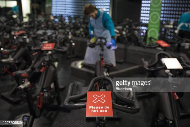 Please do not use' notice sits in on a spin bicycle at a Pure Gym Group Plc health club, as they prepare for reopening from July 25, in the City of...