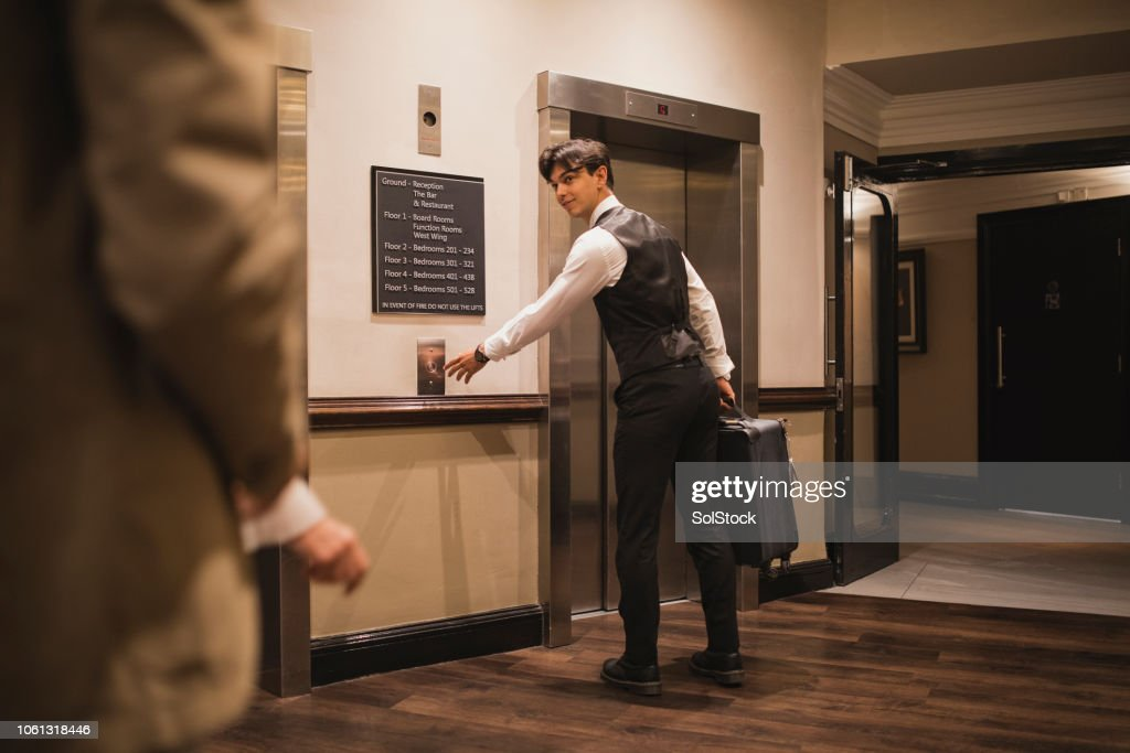 Please Follow Me To Your Room : Stock Photo