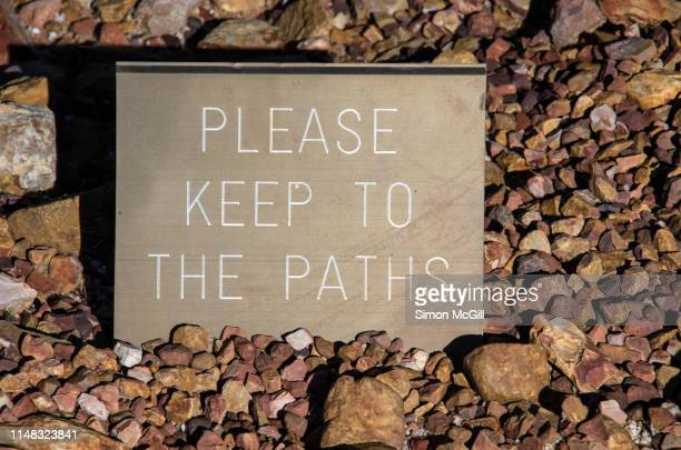 'please keep to the paths' warning sign in a garden bed - rules stock pictures, royalty-free photos & images