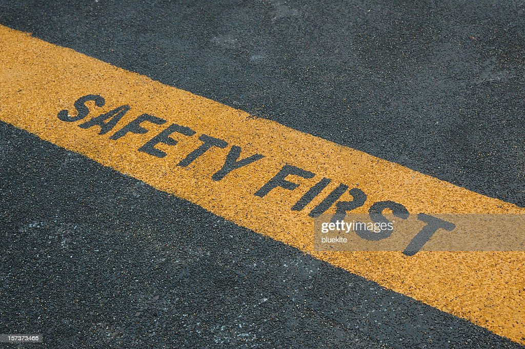 Please stand behide the yellow line! : Stock Photo