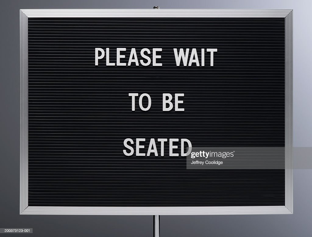 Please Wait To Be Seated Sign Closeup Stock Photo Getty Images