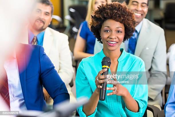 Pleased African American Woman addressing speaker