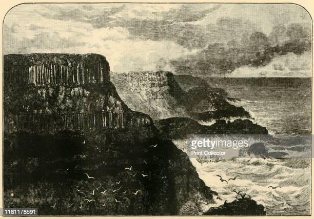Pleaskin Head Anrim' 1898 Pleaskin Head on the Atlantic Ocean at the Giant's Causeway in County Antrim with interlocking volcanic basalt columns is...