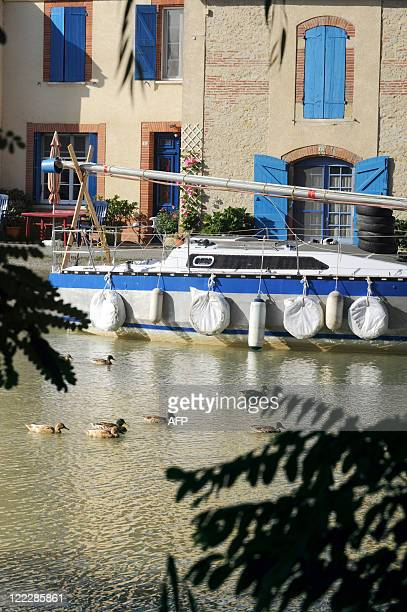 A pleasure boat is anchored on August 27 at the Gardouch lock in the Lauragais area on the banks of the Canal du Midi in Toulouse southwestern France...