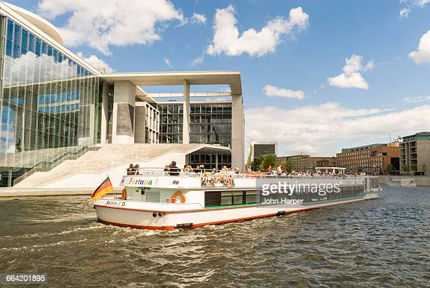 pleasure boat on river spree, berlin, germany - spree river stock pictures, royalty-free photos & images