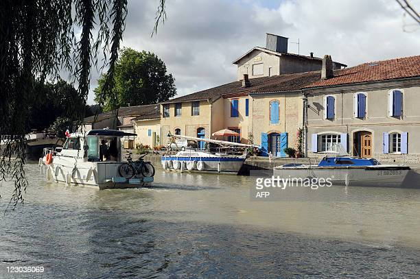 A pleasure boat sails on August 27 at the Gardouch lock in the Lauragais area on the banks of the Canal du Midi in Toulouse southwestern France The...