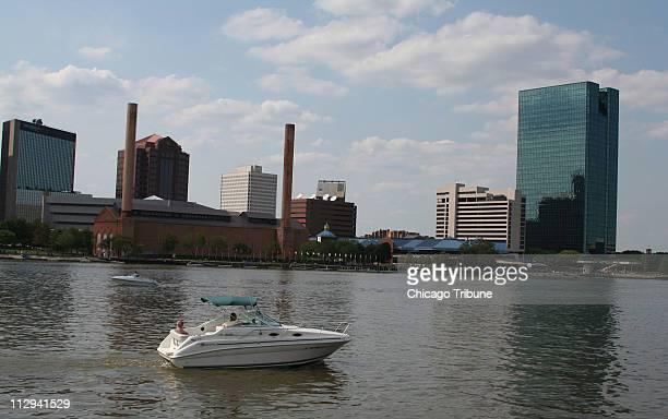Pleasure boat sails the Maumee River past downtown Toledo, Ohio, July 20, 2006.