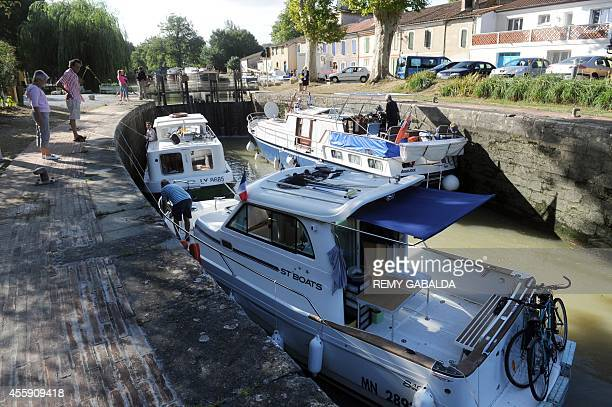 Pleasure boats cross the Gardouch lock in the Lauragais area on August 27 on the banks of the Canal du Midi in Toulouse southwestern France The...