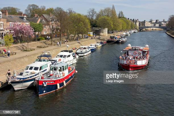 Pleasure boats moored along the River Ouse in spring.