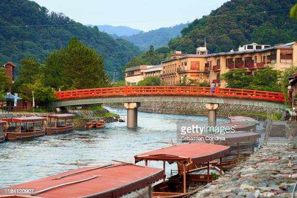 pleasure boats waiting for tourists in uji river cormorant fishing, kyoto, japan travel, jr route. - uji kyoto stock pictures, royalty-free photos & images