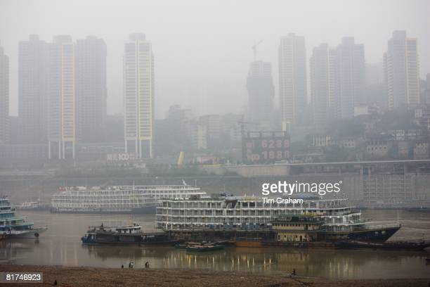 Pleasure cruisers from Victoria Line awaiting Western passengers for Yangtze River cruise Chongqing China