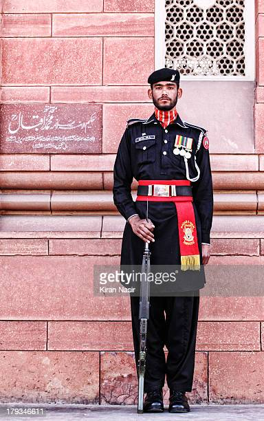 Pleasure in the job puts perfection in the work. Aristotle. Frontier Core Guard on duty, guarding Sir Muhammad Iqbal Tomb.Allama Iqbal, was a...
