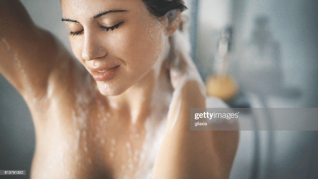 Pleasure of a shower. : Stock Photo