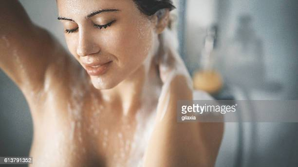 pleasure of a shower. - shampoo stockfoto's en -beelden