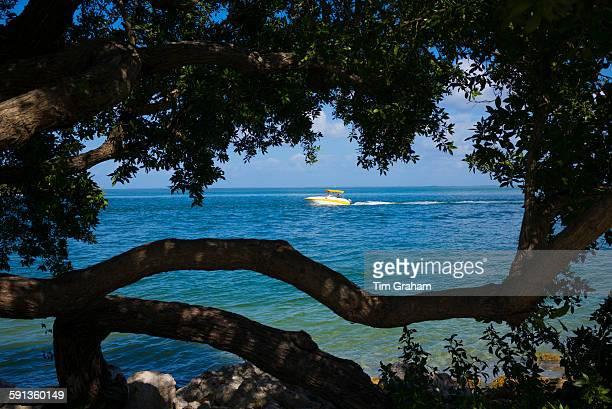 Pleasure power boat sailing in Gulf of Mexico off coast of Captiva Island Florida USA