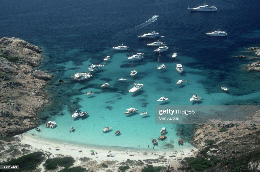 Pleasure yachts moored in a sandy cove at Porto Rotondo, Sardinia, July 1990.