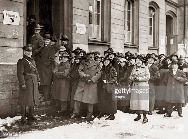 Plebiscite at the Saarland In front of a polling station a line of eligible voters are waiting for the plebiscite Germany Photograph 13 1 1935 Photo...