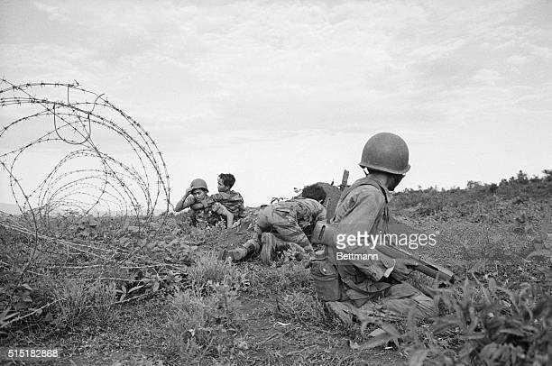 Plei Me South Vietnam Vietnamese troops hit the dirt as a Viet Cong machine gunner opens fire outside the Special Forces Camp at Plei Me during early...