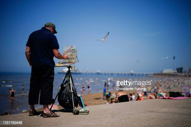 Plenair artist Adam Ralston captures the scene at Blackpool in oil paint on June 24, 2020 in Blackpool, United Kingdom. The UK is experiencing a...