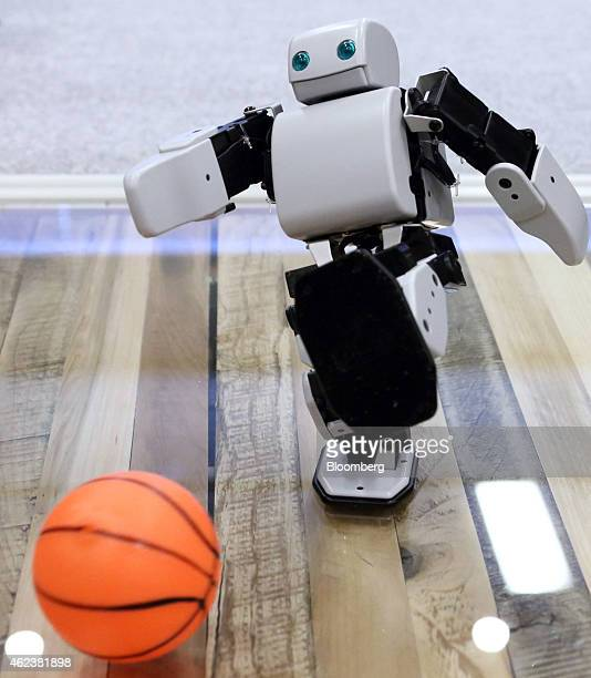 A PlenD robot kicks a ball during a demonstration at an event hosted by DMM Com Ltd in Tokyo Japan on Tuesday Jan 27 2015 DMM Com a digital contents...