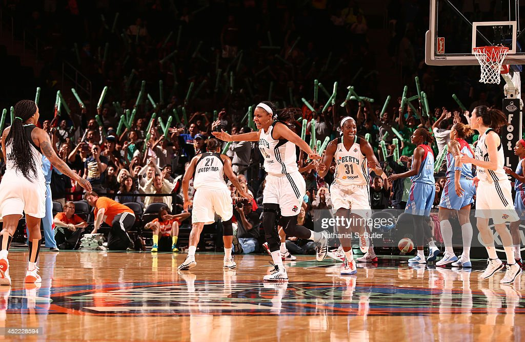 Plenette Pierson #33 and Tina Charles #31 of the New York Liberty react during a game against the Atlanta Dream at Madison Square Garden in New York City on July 16, 2014.