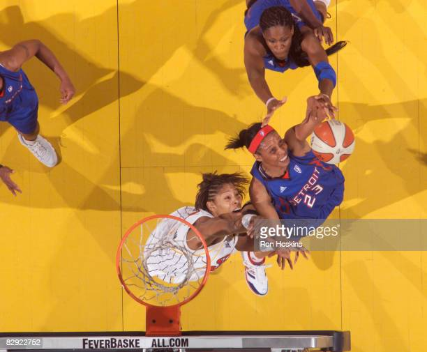 Plenette Pierson of the Detroit Shock battles Khadijah Whittington of the Indiana Fever in Game One of the Eastern Conference Semifinals during the...