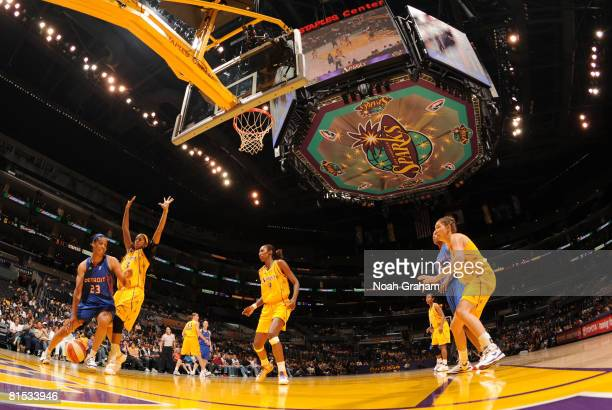 Plenette Pierson of the Detroit Shock drives along the baseline against Candace Parker of the Los Angeles Sparks at Staples Center on June 11 2008 in...