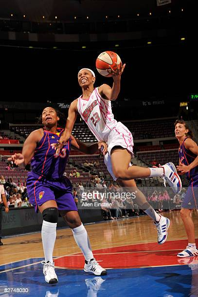 Plenette Pierson of the Detroit Shock goes for a layup against Cappie Pondexter of the Phoenix Mercury on September 9 2008 at the Palace of Auburn...