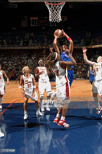 Plenette Pierson of the Detroit Shock goes to the basket against Asjha Jones of the Connecticut Sun in game three of the WNBA Eastern Conference...
