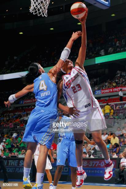 Plenette Pierson of the Detroit Shock lays up a shot under pressure against Candice Dupree of the Chicago Sky during the WNBA game on July 16 2008 at...