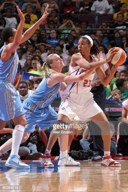Plenette Pierson of the Detroit Shock looks to pass the ball under pressure against Brooke Wyckoff of the Chicago Sky during the WNBA game on July 16...