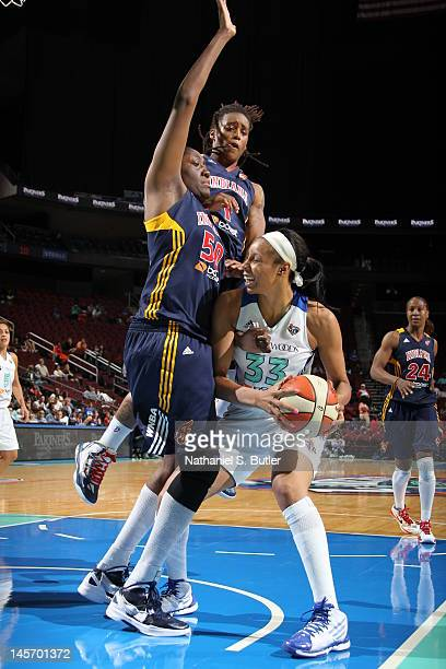 Plenette Pierson of the New York Liberty controls the ball against Jessica Davenport of the Indiana Fever during a game on June 3 2012 at the...
