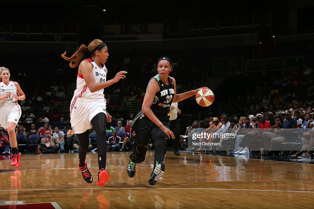 Plenette Pierson #33 of the New York Liberty handles the ball against Tianna Hawkins #21 of the Washington Mystics at the Verizon Center on August 16, 2014 in Washington, DC.