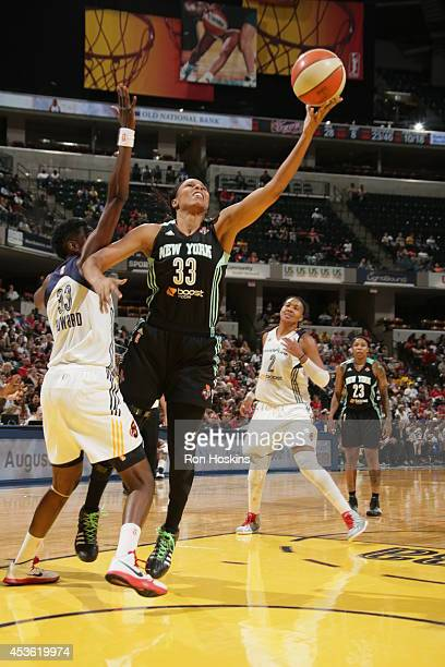 Plenette Pierson of the New York Liberty shoots the ball against Natasha Howard of the Indiana Fever on August 14 2014 at Bankers Life Fieldhouse in...
