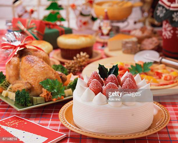 plenty dishes arranged for christmas dinner - christmas cake stock photos and pictures