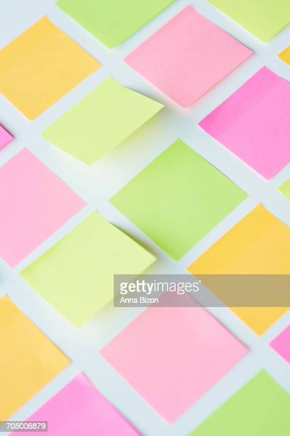 Plenty of adhesive notes stuck on the table. Debica, Poland