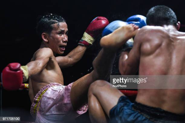 Plerngarom in action against Pongsin during Thai boxing combat in 54kg category Muaythai Monday Evening International Thai Boxing Gala in Thaphae...