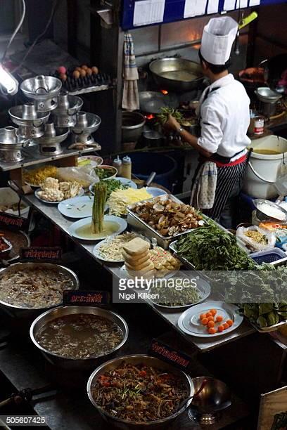 Plethora of fresh curries and ingredients at a street food vendor Bangkok