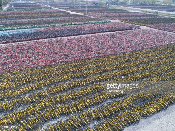 plethora of shared bikes parking lot at shanghai city,China.Photo by drone