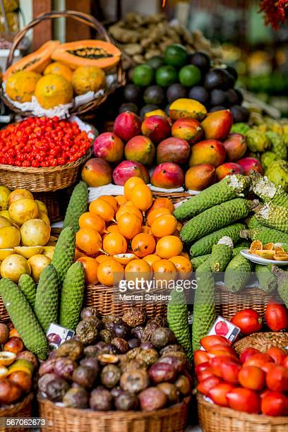 plethora of tropical fruits on offer - madeira island stock photos and pictures
