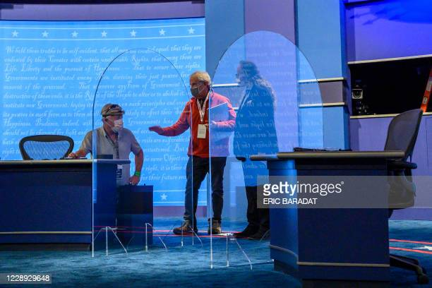 Plexiglass protections between the debaters are seen on the stage of the debate hall ahead of the vice presidential debate in Kingsbury Hall of the...