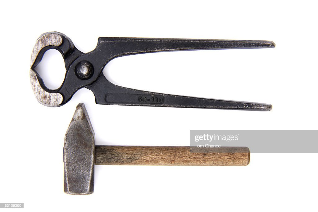Pliers and hammer, elevated view : Stock Photo
