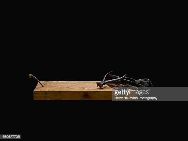 pliers and rusty nail on black background. - heinz baumann photography stock-fotos und bilder