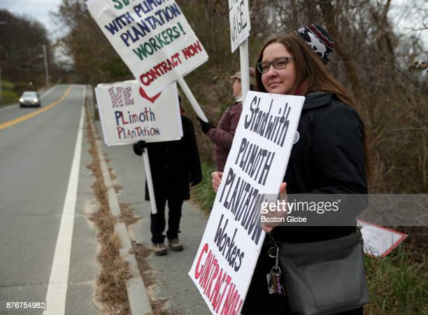 Plimoth Plantation historical interpreter Alexandra Cervenak holds a sign protesting stalled contract negotiations with the sites management on the...