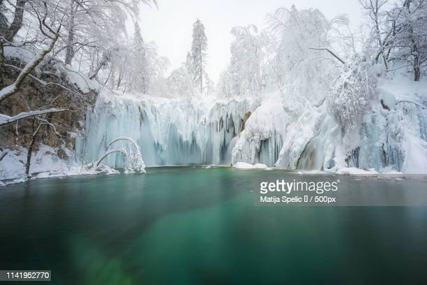 plitvice lakes frozen fairytale - unesco stock pictures, royalty-free photos & images
