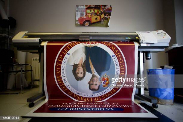 Plotter machine prints a giant banner advertising souvenirs on sale of Prince Felipe and Princess Letizia as future Spanish monarchs at LK...